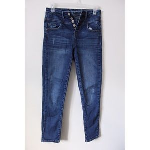 A pair of slim-fitted blue high-waisted jeans